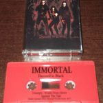 Immortal ‎– Damned In Black